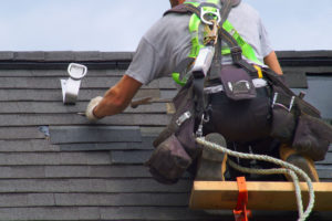 roof repair under spotlight