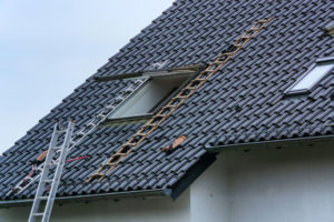pitched roof roofing contractor staying safe safety ladder in place